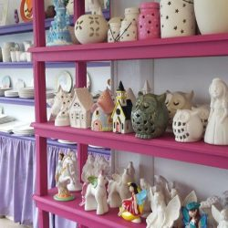 pottery on shelves ready for painting