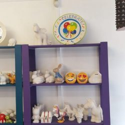 character pottery on shelves ready for painting